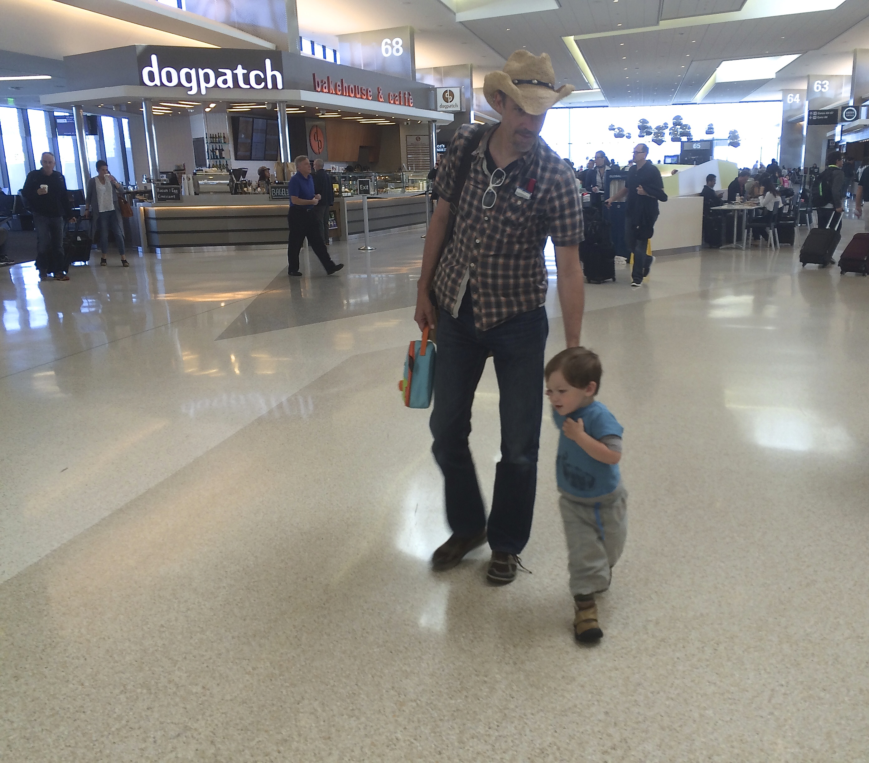 conor_dad_airport_holdinghands